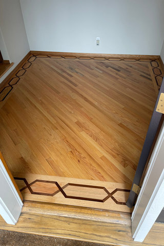 Refinished wood floor in entry