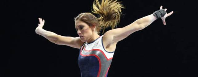 UA GymCats win opener; latest to draw a record crowd
