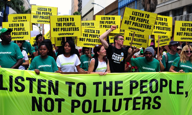 Greenepace joined over a thousand climate activists who took to the streets of Durban on Saturday to call on governments at the COP-17 climate talks to listen to the people and not the poluters. Picture: Shayne Robinson