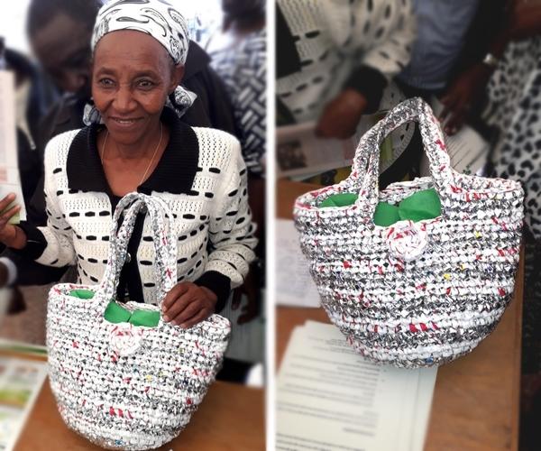 Woman carrying bag made of plastics