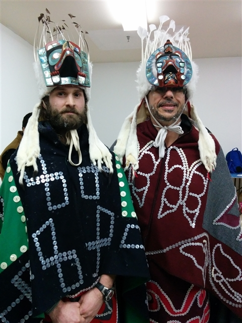 Greenpeace staff Mark Worthing and Eduardo Sousa, in Kwakwaka'wakw regalia preparing for Peace Dance, Willie Family Potlatch and Greenpeace Sisiutl Renewal Ceremony March 2015