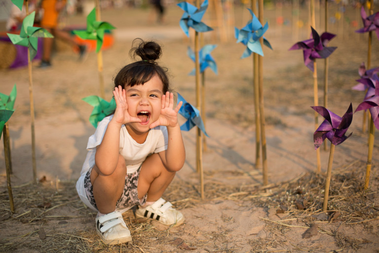 Little Girl with Windmills at Wonderfruit Festival in Thailand