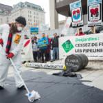 #NoToPipelines Action at Desjardins General Assembly in Quebec