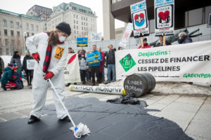 #NoToPipelines Action at Desjardins General Assembly in Quebec