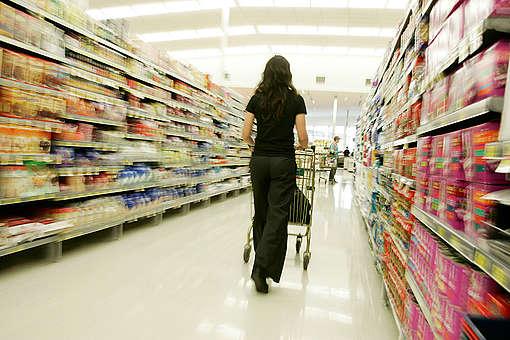 Shopper in supermarket. © Nigel Marple