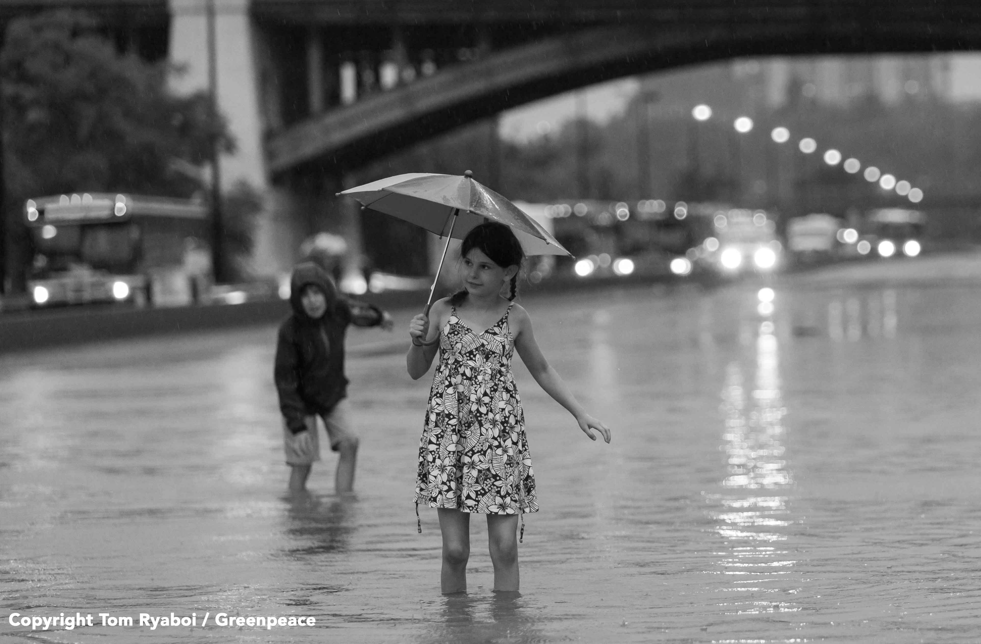 Girl walks through water on the flooded DVP during the July 2013 flash flood