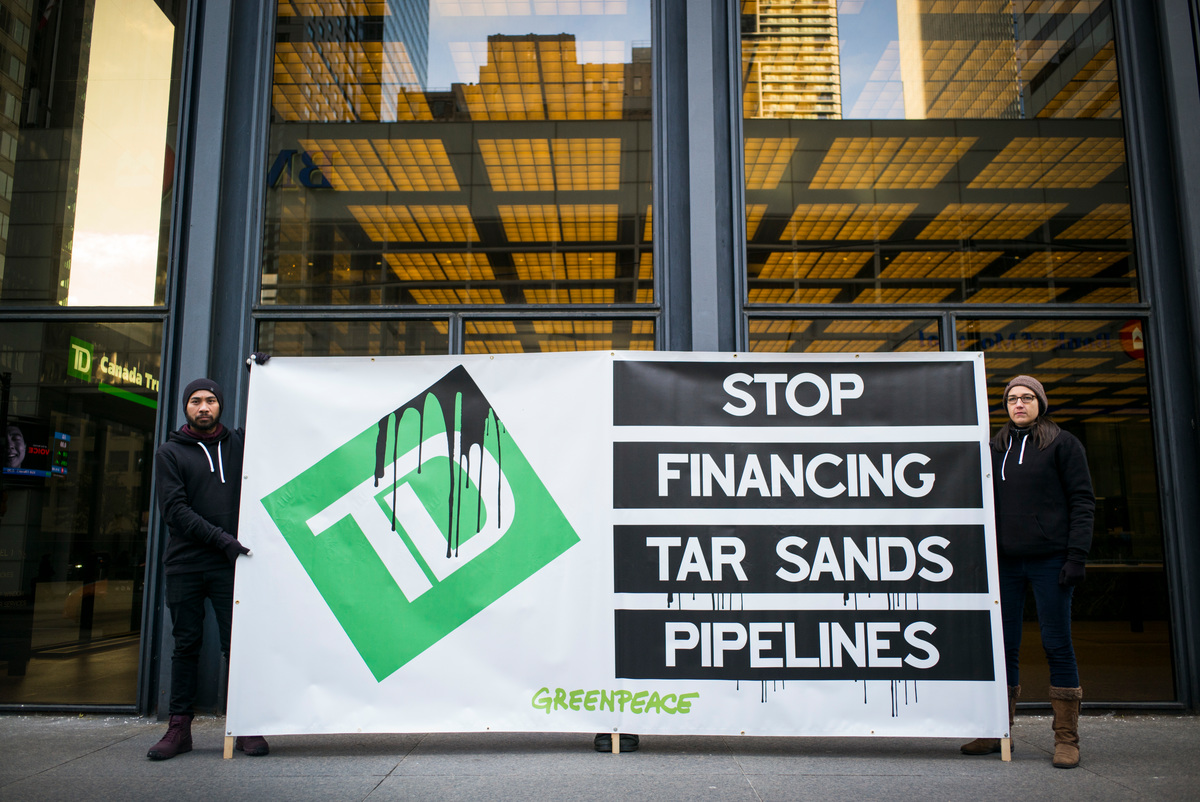 Action at TD Bank in Toronto. © Ian Willms / Greenpeace