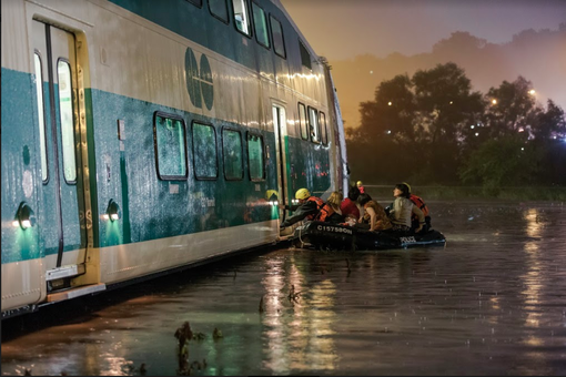 Police boats rescue travellers on the GO Train in Toronto during the 2013 floods.