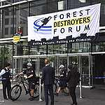 Breaking News: Greenpeace activists scale Vancouver Convention Centre to protest global brands' role in climate crisis