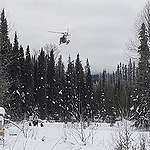 RCMP helicopter drops off tactical teams in Wet'suwet'en territory. February 2020. © Jerome Turner/RicochetRCMP