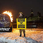Burning call to Reject Teck in Ottawa, Canada. © Greenpeace