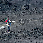 Marc Defourneaux holding Umbrella. © Greenpeace / Timothy A. Baker