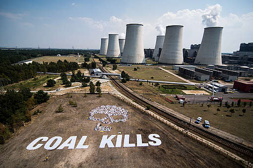 Banner Action against Lignite in Front of Jaenschwalde. © Chris Grodotzki / Greenpeace