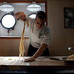 Cook on MY Esperanza. © Nick Cobbing / Greenpeace