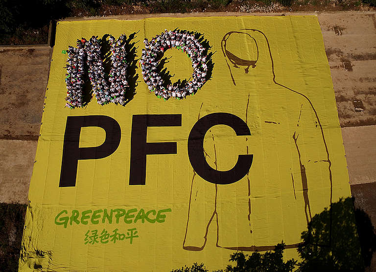 """NO PFC"" Human Banner Action in China. © Young Xu / Greenpeace"