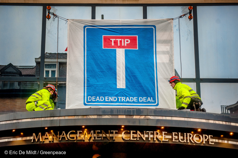 Greenpeace action againt TTIP negotiations in Brussels. Activists block the entrances to the negotiations take take place in conference centre in Ixelles, Brussels, Belgium.   / © Eric de Mildt - Greenpeace / Mention of name obligatory / All rights reserved.