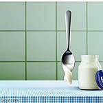 Yoghurt and spoon. Joghurt und Loeffel.