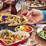 Family Eating Vegetarian Food at Home in Vienna. © Mitja  Kobal