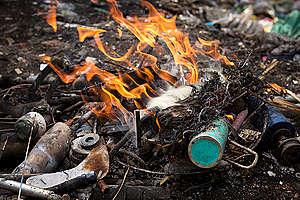 Burned Waste in Manila. © Daniel Müller / Greenpeace