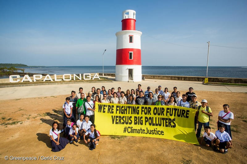 participants of the forum on Climate Change Adaptation and Mitigation pose for a photo op at the lighthouse in Capalonga, Camarines Sur. A resolution