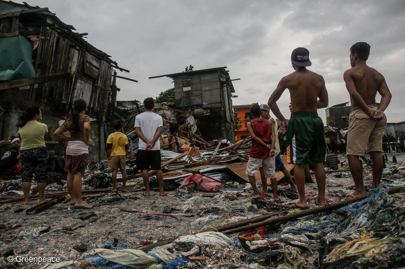 People look for recyclable materials after their houses were destroyed by strong winds and waves along the shores of Navotas in Manila, Philippines on Monday. August 13, 2018. Heavy rainfall and strong winds brought by the southwest monsoon enhanced by tropical storm Yagi, displaced thousands of people and left many parts of the metro flooded over the weekend.