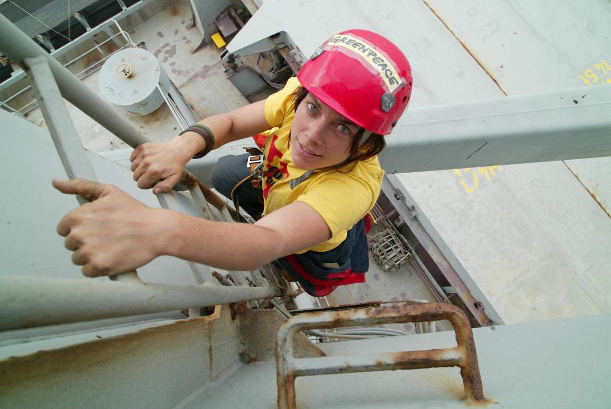 Activist Ascends Ladder in an Action to Block Unloading of GE Soya. © Kate Davison