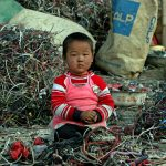 Child and e-waste, Guiyu, China © Natalie Behring / Greenpeace