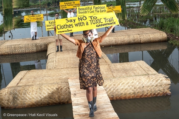 """Indonesian models wear eco fashion apparels designed by Indonesian well known designers Felicia Budi, Indita Karina, Lenny Agustin during """"Detox Catwalk"""" organised by Greenpeace in the polluted paddy field in Rancaekek, West Java"""