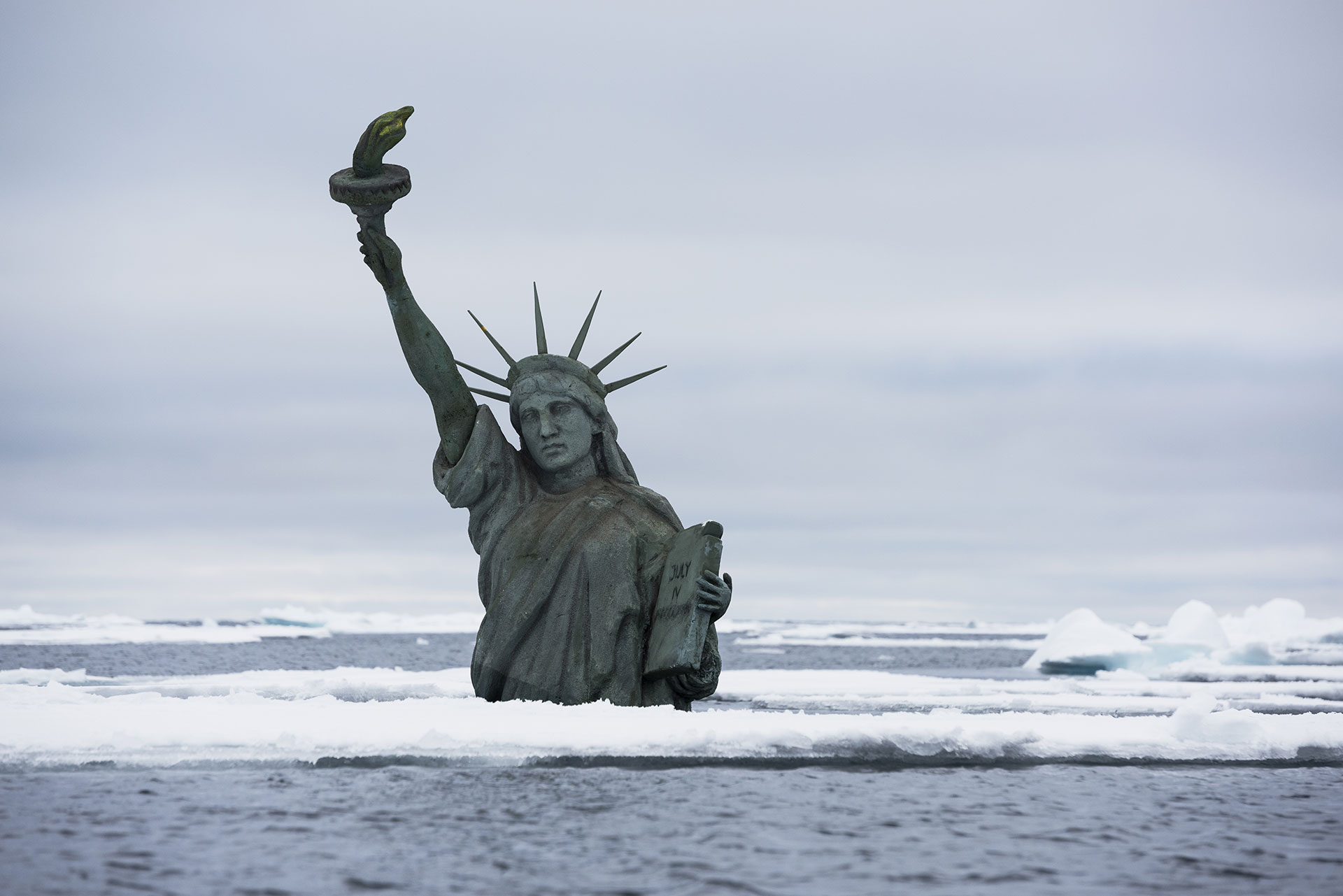 Statue of Liberty action at the Arctic Sea ice edge. © Christian Åslund / Greenpeace
