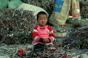 Child in toxic e-Waste in China © Greenpeace / Natalie Behring