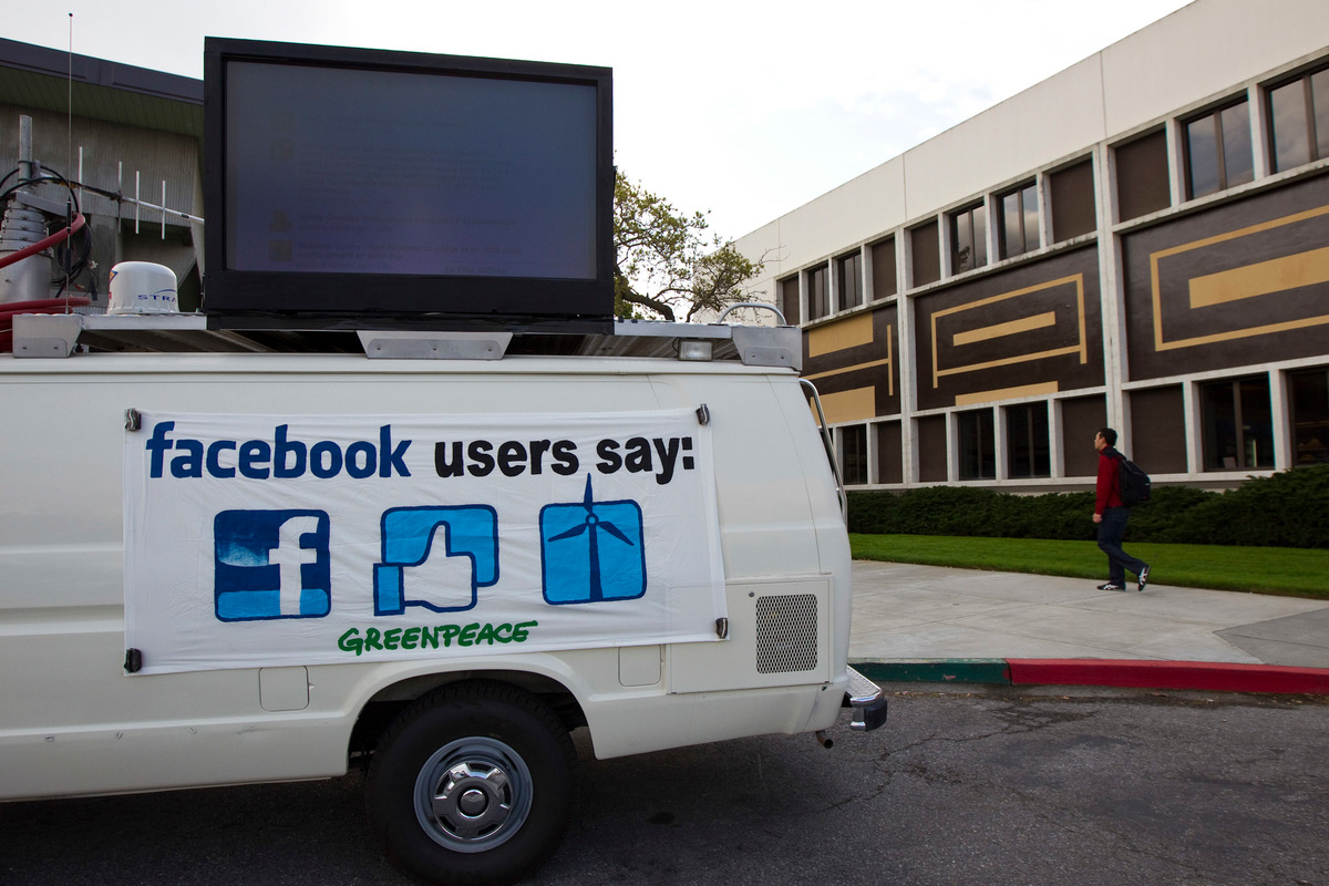 Facebook posts display at headquarters © Kim White / Greenpeace