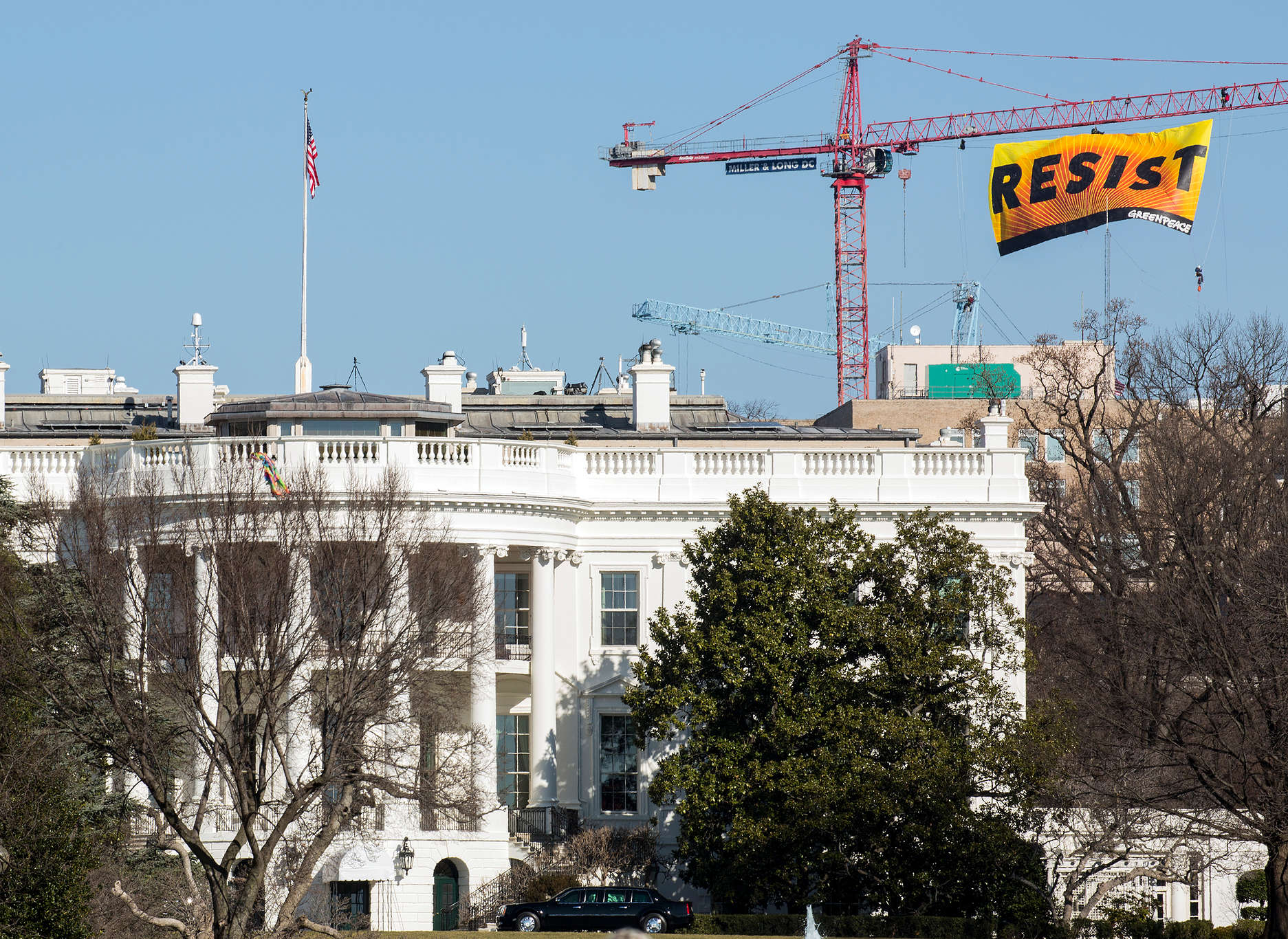Resist Trump Banner Action in Washington D.C. © Tim Aubry