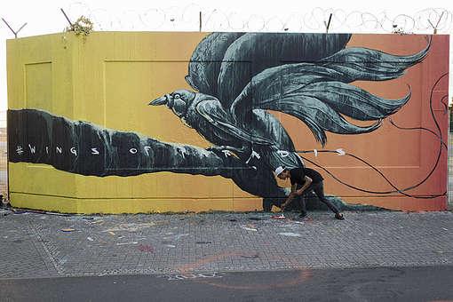 Wings of Paradise Mural in Berlin. © Chris Grodotzki