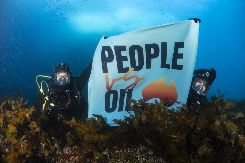 Two divers with a People Vs Oil banner underwater in the Great Australian Bight