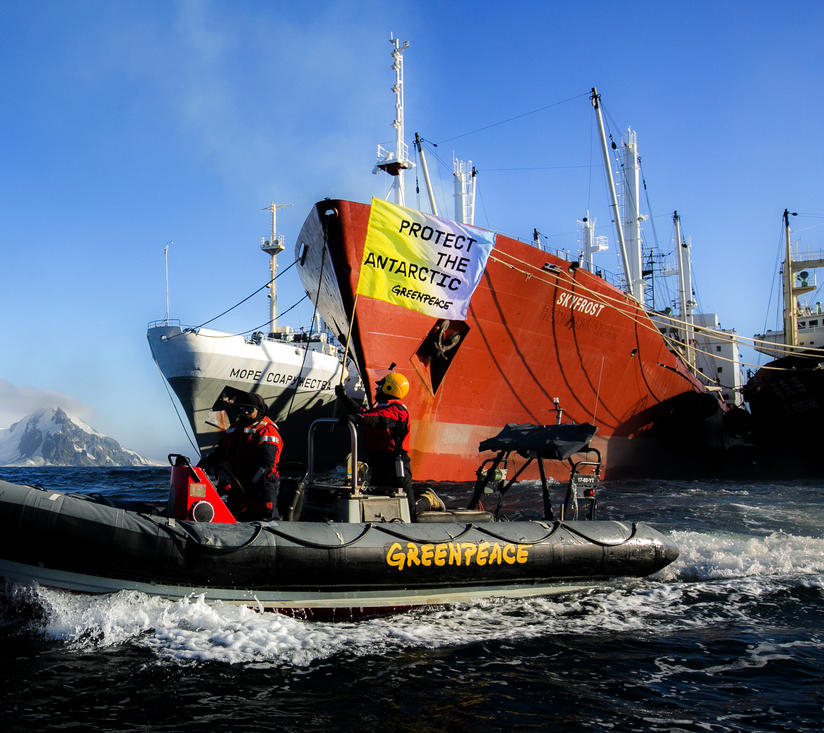 Greenpeace activists peacefully protesting in front of the Ukrainian krill trawler 'More Sodruzhestva' in the Bransfield Strait near Greenwich Island, Antarctic. © Paul Hilton / Greenpeace