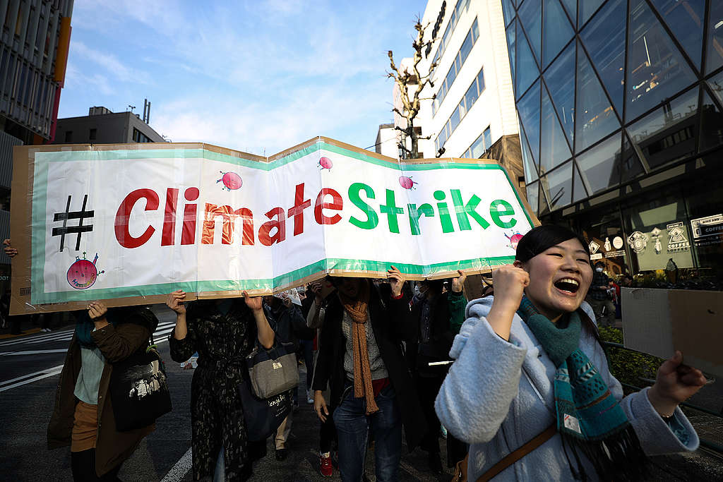 TOKYO, JAPAN - MARCH 15: Participants hold signs and shout slogans during the Fridays for Future march on March 15, 2019 in Tokyo, Japan. Students around the world took to the streets on March 15 to protest a lack of climate awareness and demand that elected officials take action on climate change. Inspired by Greta Thunberg, the 16-year-old environmental activist who started skipping school since August 2018 to protest outside Sweden's parliament, school and university students worldwide have followed her lead and shared her alarm and anger. Takashi Aoyama/Getty Images