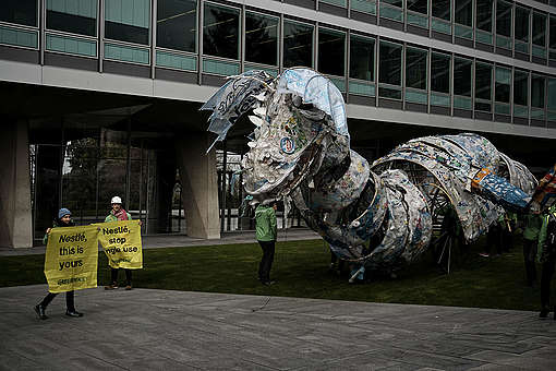 Plastic Monster Action at Nestlé Headquarters in Switzerland © Yukon Benner / Greenpeace