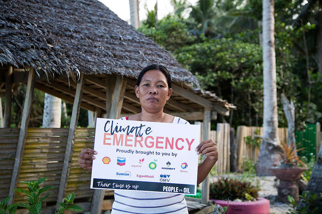 "Activists reclaim public space in Alabat, Quezon with climate emergency ""advertisements"". © Greenpeace"