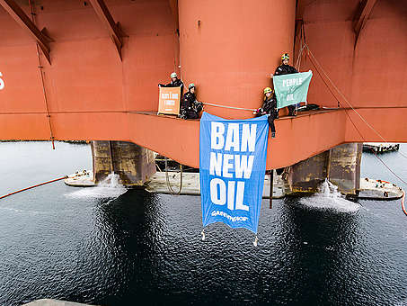 "In a peaceful protest Greenpeace activists from Norway, Sweden, Denmark and Germany climb the oil rig West Hercules, located near Rypefjord village in the north of Norway, and display a banner reading ""Ban New Oil"". While a growing movement calling for real action on climate change is happening all over the world, Equinor's rig is preparing for a season of oil drilling in the Arctic waters of the Barents Sea. © Jani Sipilä / Greenpeace"