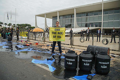 Oil Spill and Burnt Forest Action in Brazil. © Christian Braga / Greenpeace