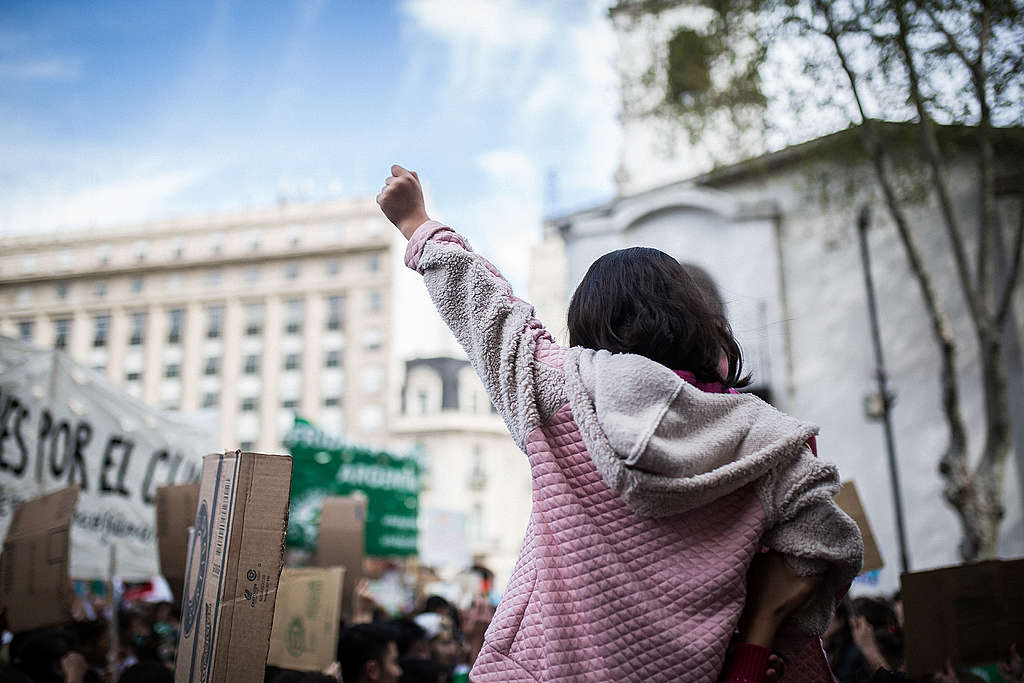 ©Nicolás Villalobos/Greenpeace Young activist at a climate march in Buenos Aires, Argentina