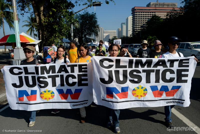 "Participants of the ""Climate Walk: A People's Walk for Climate Justice""during it's kick off at the historic kiilometer Zero in Luneta in Manila, organised by the climate advocates from Philippine Climate Change Commission, Greenpeace, National Youth Commission, Philippine Rural and Reconstruction Movement, Philippine Movement for Climate Justice, Aksyon Klima, Sanlakas, Dakila and other civic groups.Climate Walk is a 40-day, 875 KM journey from Manila to the ground zero in Tacloban City by the 8th of November, to commemorate the first anniversary of super typhoon Yolanda (Haiyan), a historic landfall in the Philippines. The organisers hope to raise awareness on climate change and mobilise people in demanding world leaders to take climate action and hold industry polluters  and their respective governments accountable for their contribution to the climate crisis."
