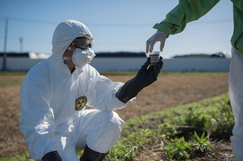 29 September 2017 - Greenpeace radiation specialists Mai Suzuki and Heinz Smital in Namie taking soil samples in Namie, Fukushima prefecture. In March 2017 the Japanese government opened this area of Namie for people to return to. Greenpeace radiation surveys of this area in September 2017 showed that while some of the area has levels close to the government decontamination target (0.23 micro-sieverts per hour) there were many areas which were higher. 10km north of the Fukushima Daiichi nuclear plant, this area was heavily damaged by the March 2011 earthquake and tsunami. As of December 2017 the population of Namie was 440, 2.1% of the population in March 2011.