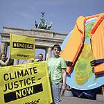 Earth with Life Jacket at Petersberg Climate Dialogue in Berlin. © Gordon Welters