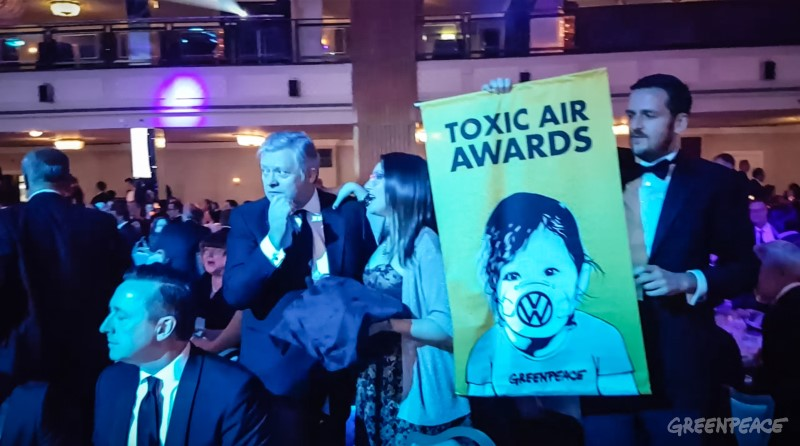 Volkswagen receive 'toxic air award' at SMMT annual dinner.Air pollution campaigners embarrassed senior executives from Volkswagen this evening by presenting them with an award for their contribution to toxic air at an exclusive dinner at The Grosvenor Hotel, hosted by The Society of Motor Manufacturers and Traders' and attended by over 1,000 guests from industry, government and the media.The campaigners, from Greenpeace, announced the award over loudspeaker to guests, before campaigners approached VW's table, handing Paul Willis the award.