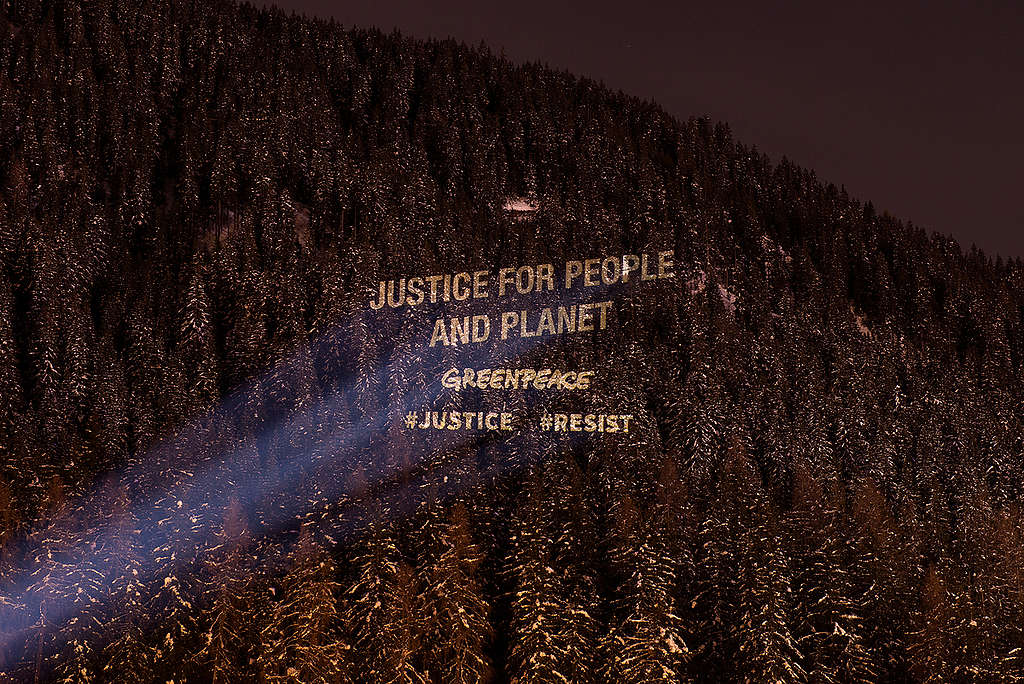Greenpeace Justice Activity at the World Economic Forum in Davos. © Lumina Obscura