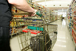 Shopping trolley in supermarket. © Greenpeace / Nigel Marple