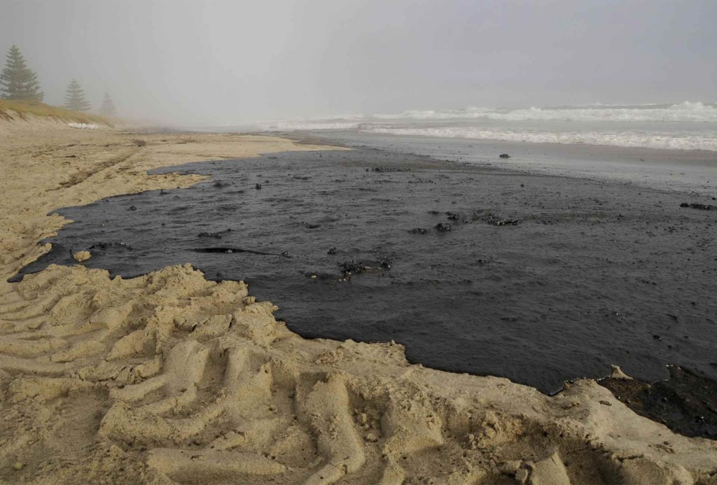 Oil covers a section of Papamoa beach, spilled from the Rena, a container ship which ran aground the Astrolab Reef, about 20km from Tauranga on October 5th.