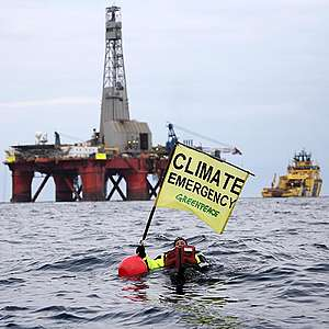 Greenpeace activist swims in front of BP rig in latest attempt to stop it reaching drill site