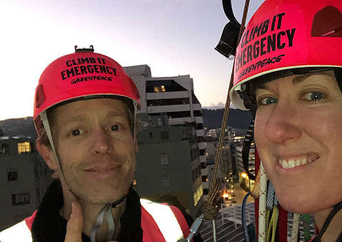 Abi and Nick on their climb up the Majestic Centre in Wellington to deliver a message OMV